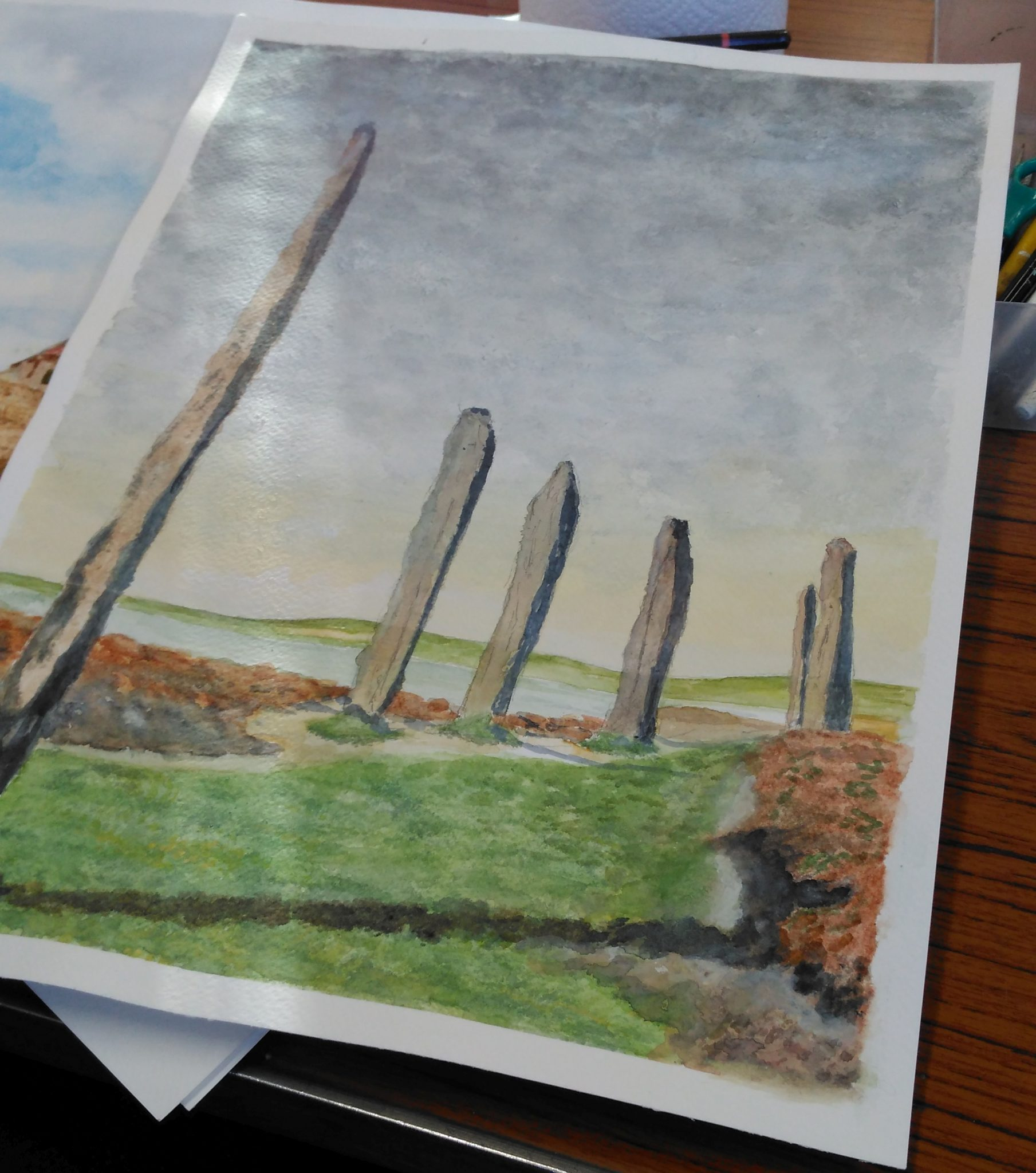 A watercolour of standing stones.