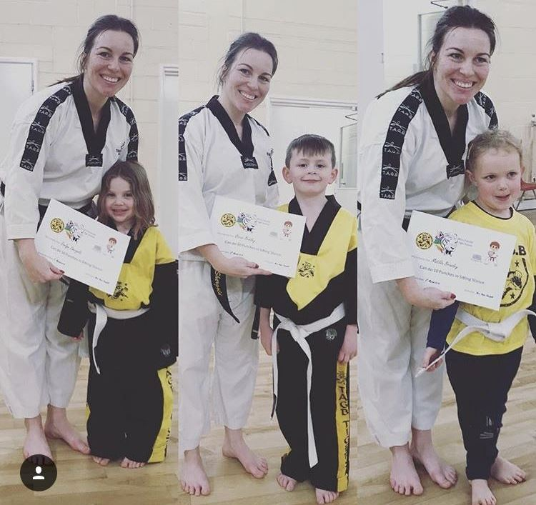 Aimee with three students and their awards.