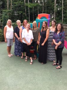 The staff from Badger Farm Pre-School getting ready for the end of term party.