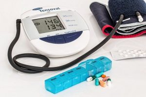 A blood pressure monitor and some pills