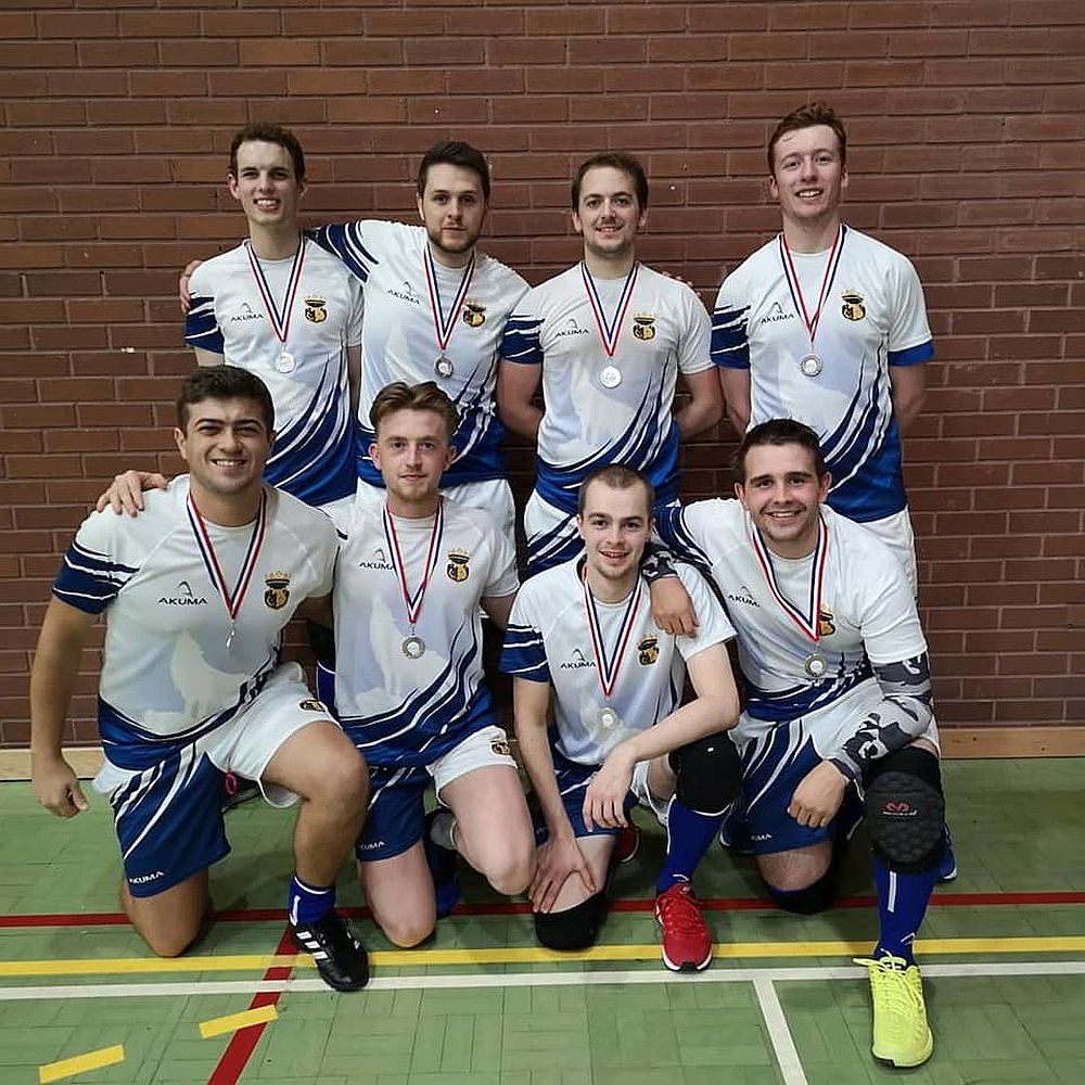 A men's dodgeball team with medals
