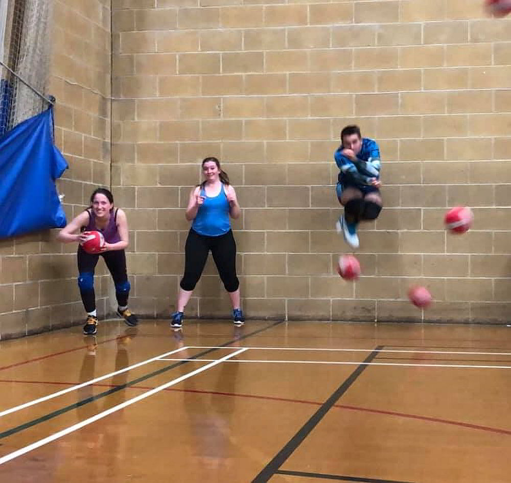 Men and women playing dodgeball