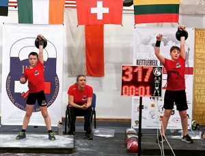 Boys taking part in a kettlebell competition