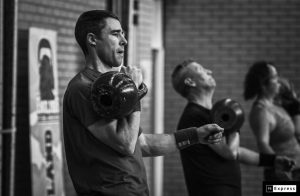 People exercising with kettlebells