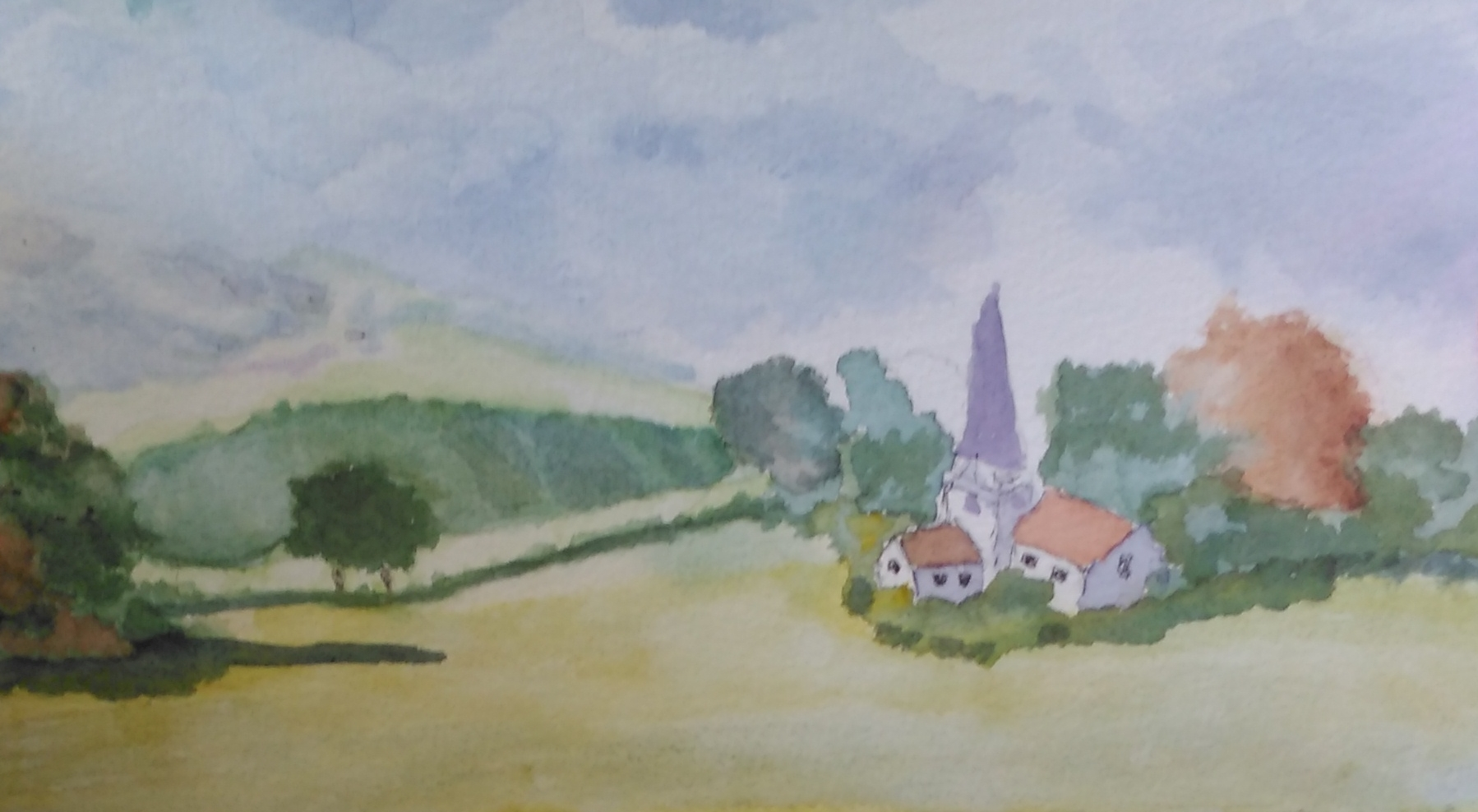 A watercolour of a peaceful church in a field with a mountain backdrop.